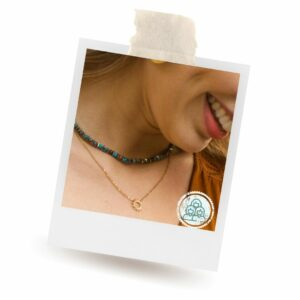 Mallory Gold Sun Pendant Necklace on woman. Necklace is handmade by artisans.