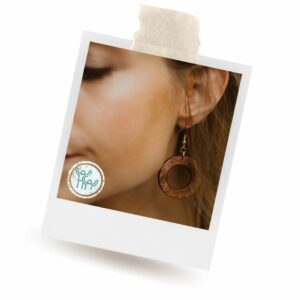 Wooden Hoop earrings worn by a woman. Ethical, sustainable earrings that give back.