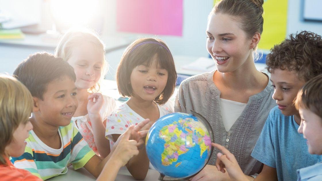 Teacher showing students a globe