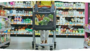 A woman walking in a supermarket. All items in the supermarket just blend in to each other, none of them stand out.
