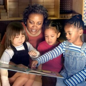 Children being read a book.