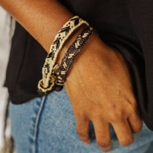 Hands Producing Hope's Handmade Orlando Bracelet. Ethical Shopping.