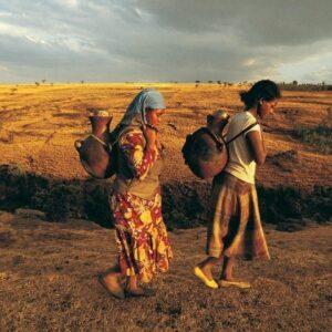 Women walking to get water.
